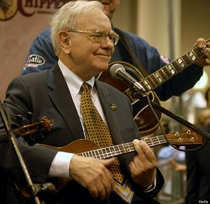 UNITED STATES - MAY 05: Berkshire Hathaway Inc. Chairman Warren Buffett plays with a blue grass band at the Qwest Center in Omaha, Nebraska, just before the start of the Berkshire Hathaway annual meeting, Saturday, May 5, 2007. Berkshire Hathaway said first-quarter profit rose 12 percent as its catastrophe reinsurance business benefited from higher prices and mild weather. (Photo by Chris Machian/Bloomberg via Getty Images)